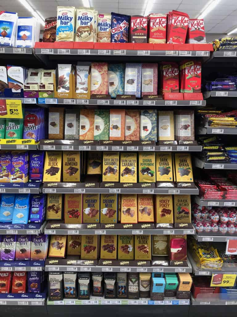 whittakers chocolate on the shelf of a grocery store