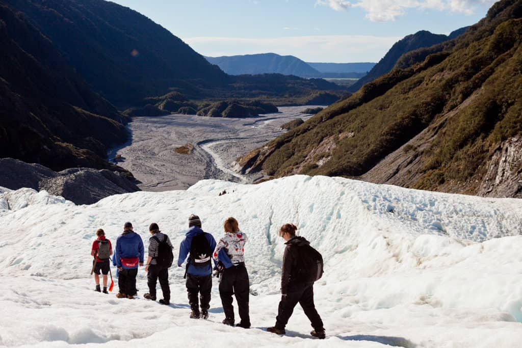 hiking franz josef glacier in new zealand as one of the top activities in the south island