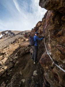 climbing red crater ridge with metal cable chain