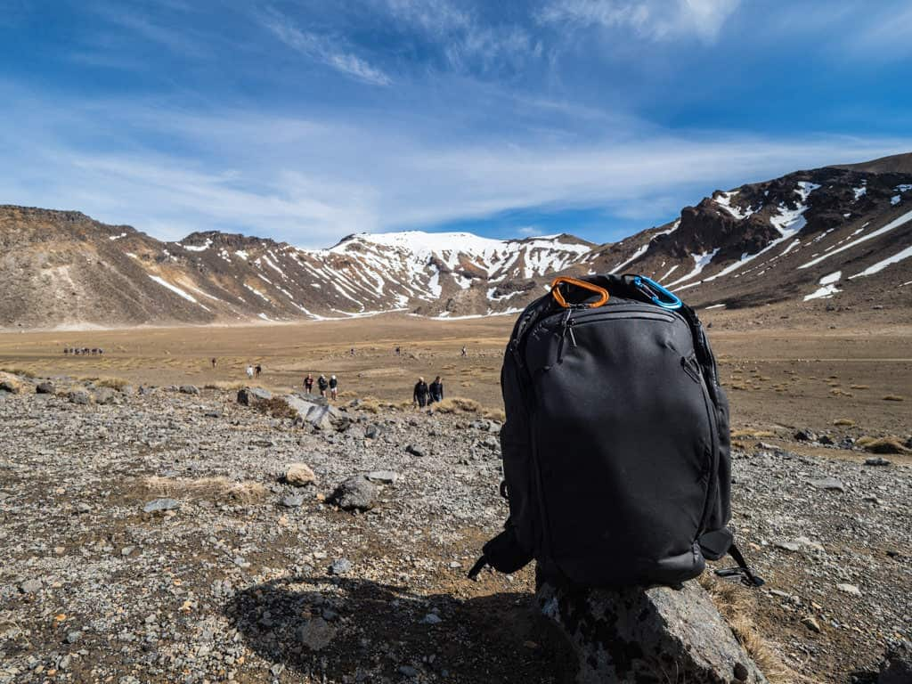 peak design travel backpack on tongariro crossing