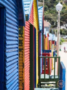 colourful changeroom houses at st james beach