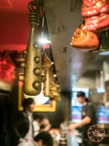 golden spiked bates dangling at kikanbo ramen in tokyo