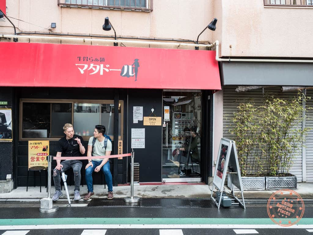 hiroshi and will in front of matador ramen shop