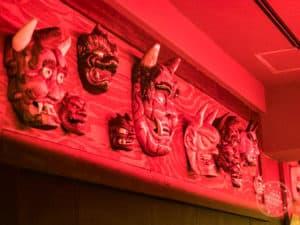 wall of oni masks at kikanbo near kanda