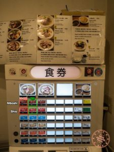 shichisai ramen ordering machine with buttons circled english