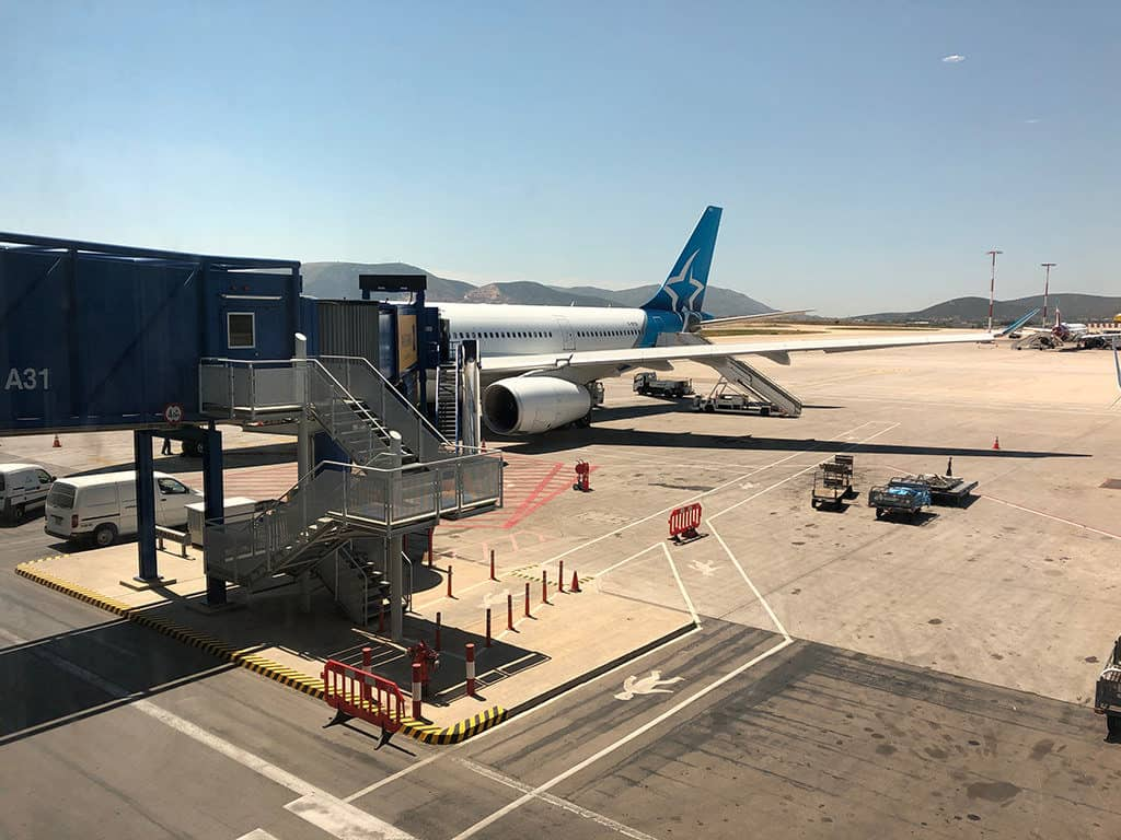 air transat airplane arrival in athens airport flight deals