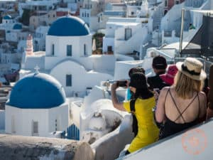 crazy line ups to take photos of the blue churches in oia