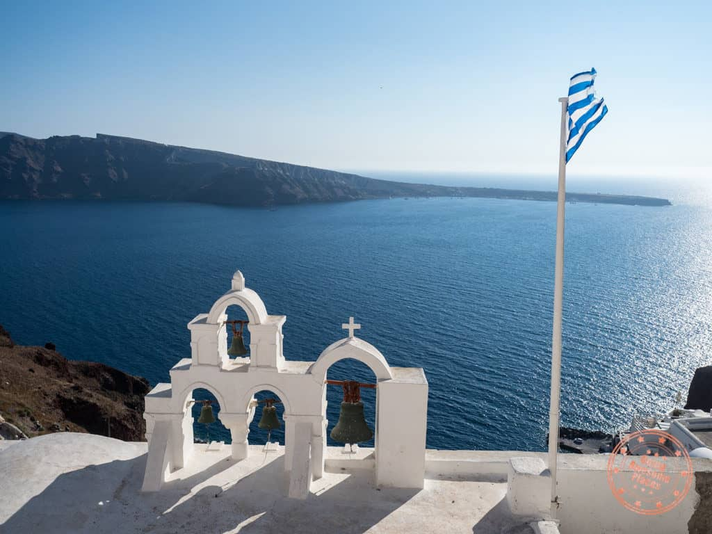 greek islands travel guide oia santorini church flag greece