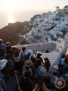 oia sunset crowd below