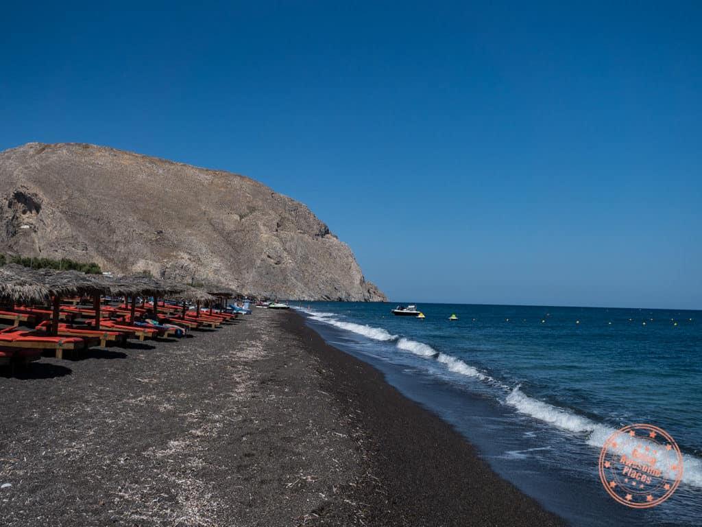 where to go in santorini perissa black sand beach