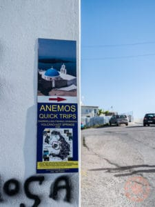 sign for famous blue topped church in santorini greece