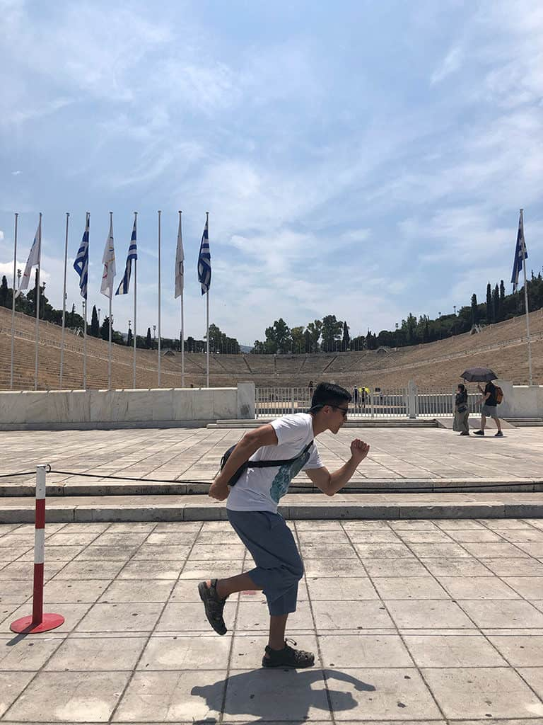 olympic panathenaic stadium athens running pose