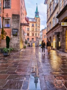 innsbruck local streets rain reflections