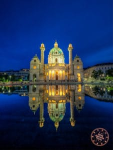 karlskirche at sunset with water reflection