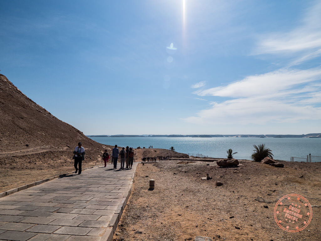 walking in to see abu simbel with lake nasser behind