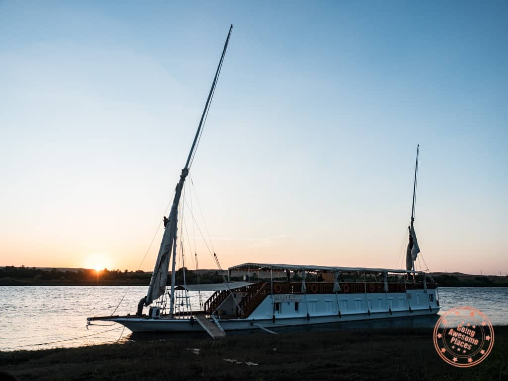 dahabiya docked at sunset along the nile