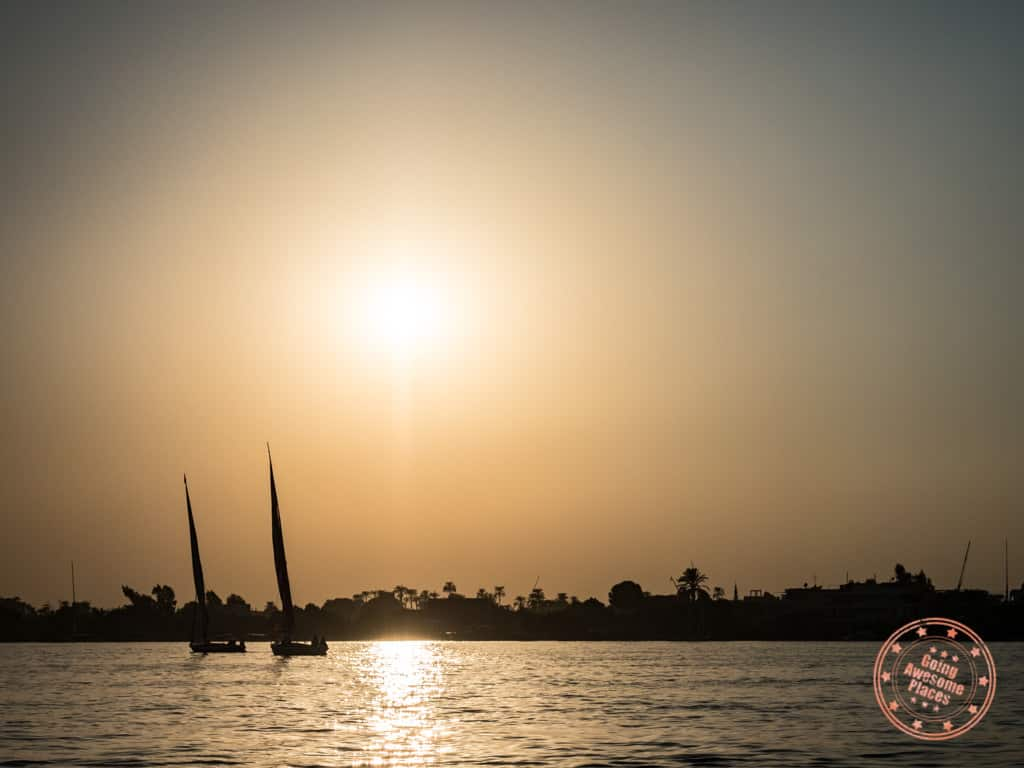 felluca sailing in luxor egypt at sunset
