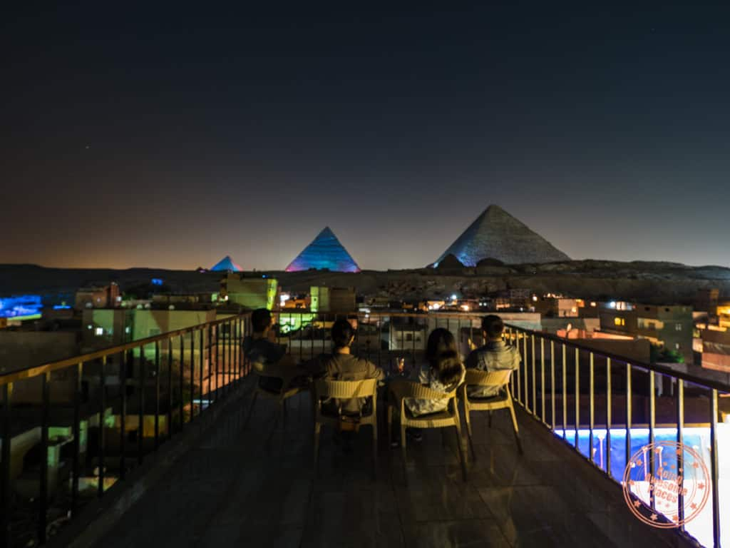 group watching pyramids sound and light show in giza