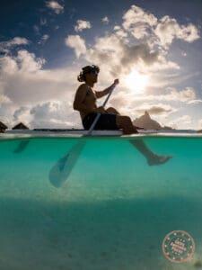 bora bora paddle boarding half underwater