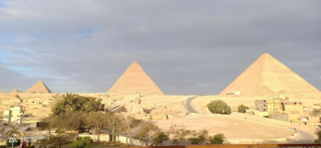 giza pyramids inn view of sphinx