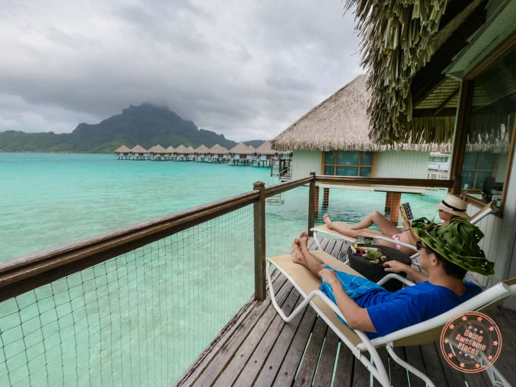 reading on the deck of le meridien bora bora