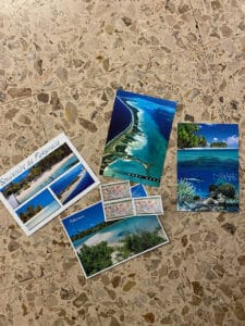 writing postcards at tahiti airport