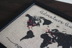 burlap world map close up with red pins