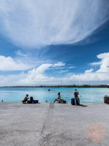 waiting for ferry in rangiroa to tiputa motu