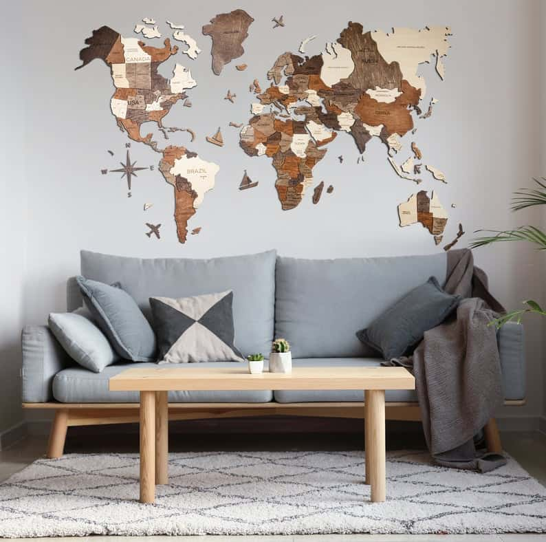 wood world map with pins in living room