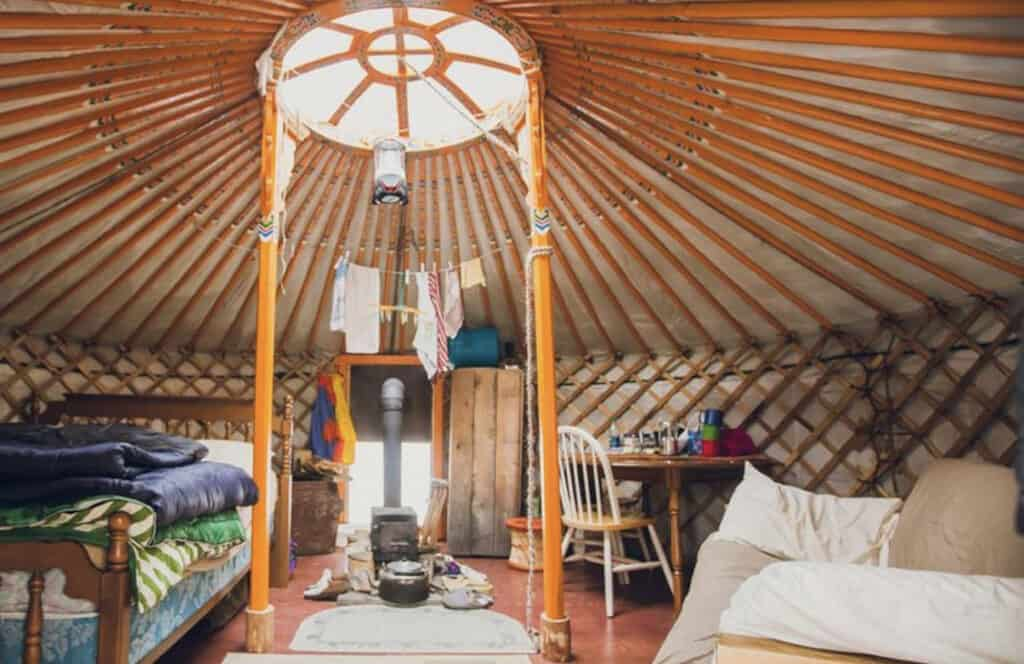 cozy yurt accommodations with light coming in the centre
