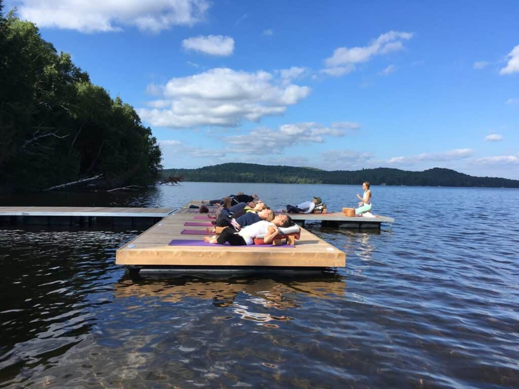 practicing yoga outdoors on dock at northern edge algonquin