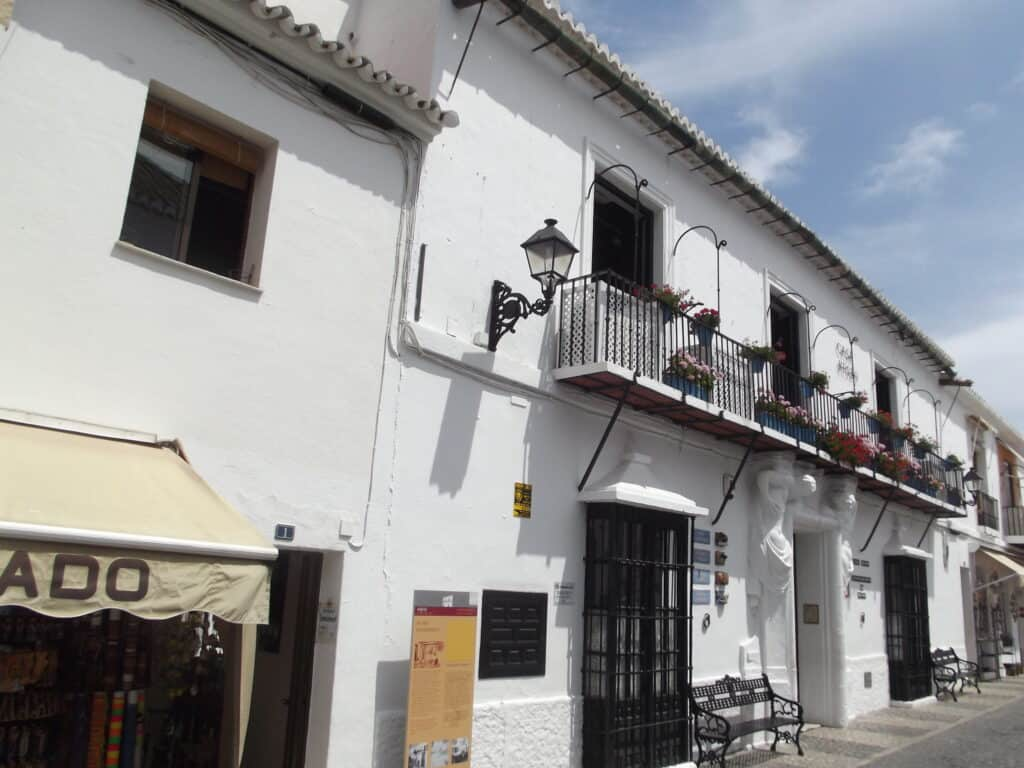 White Spanish buildings with a cafe near where Picasso worked.
