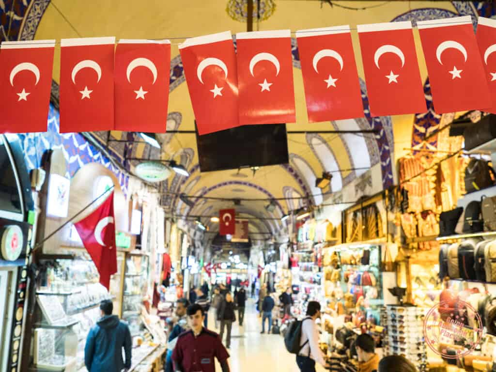 grand bazaar with a row of small flags of turkey in focus