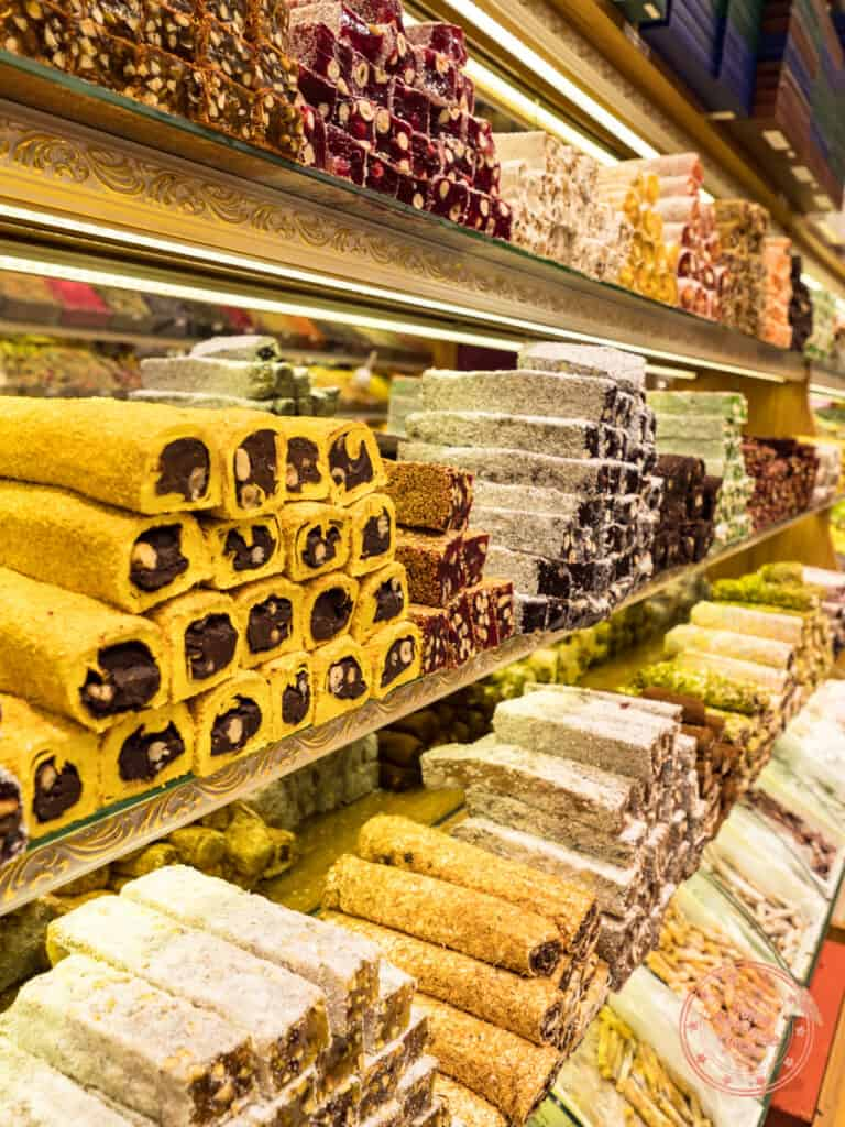 colourful stacks and shelves of turkish delight inside the grand bazaar