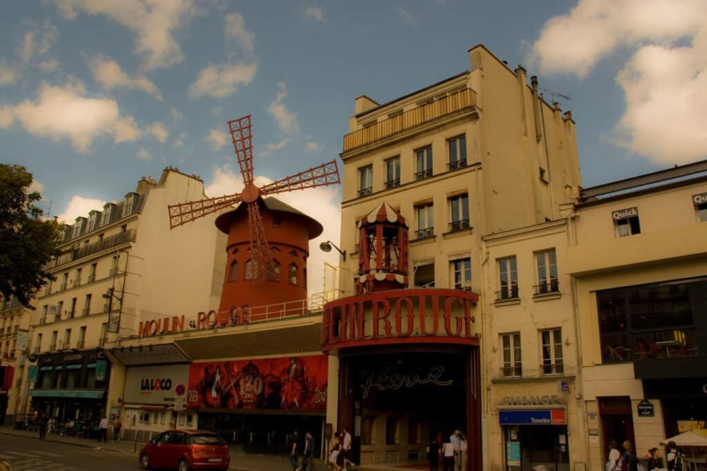 moulin rouge and iconic windmills in the montmartre neighbourhood of paris