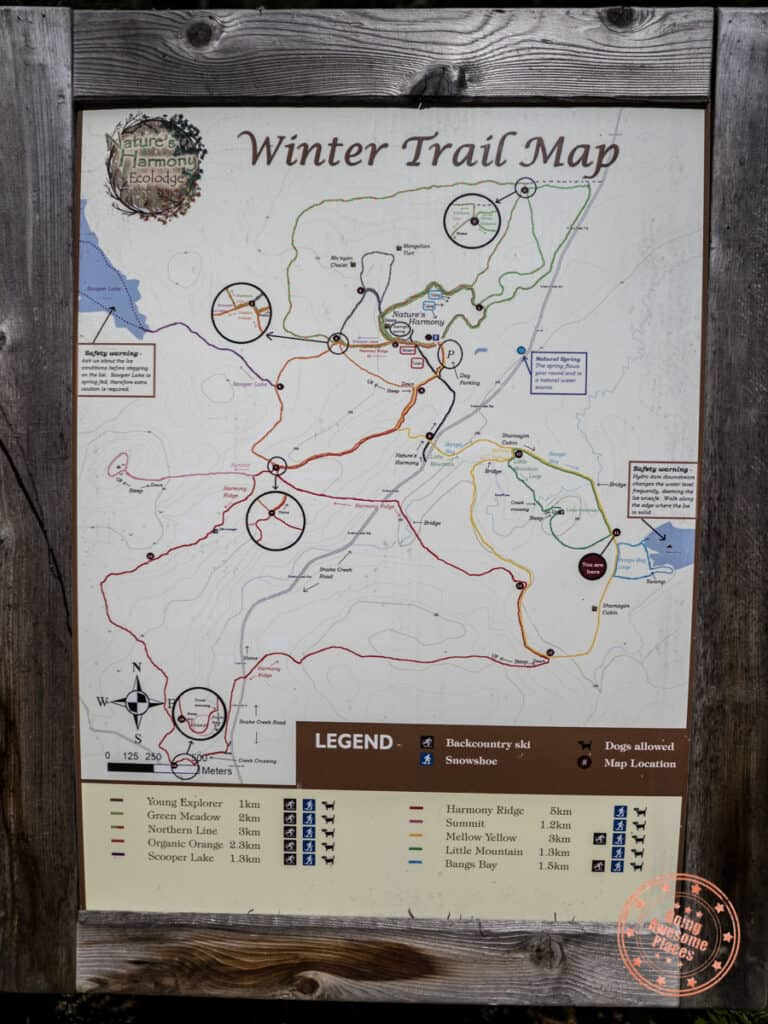 natures harmony winter trail map on a wooden board