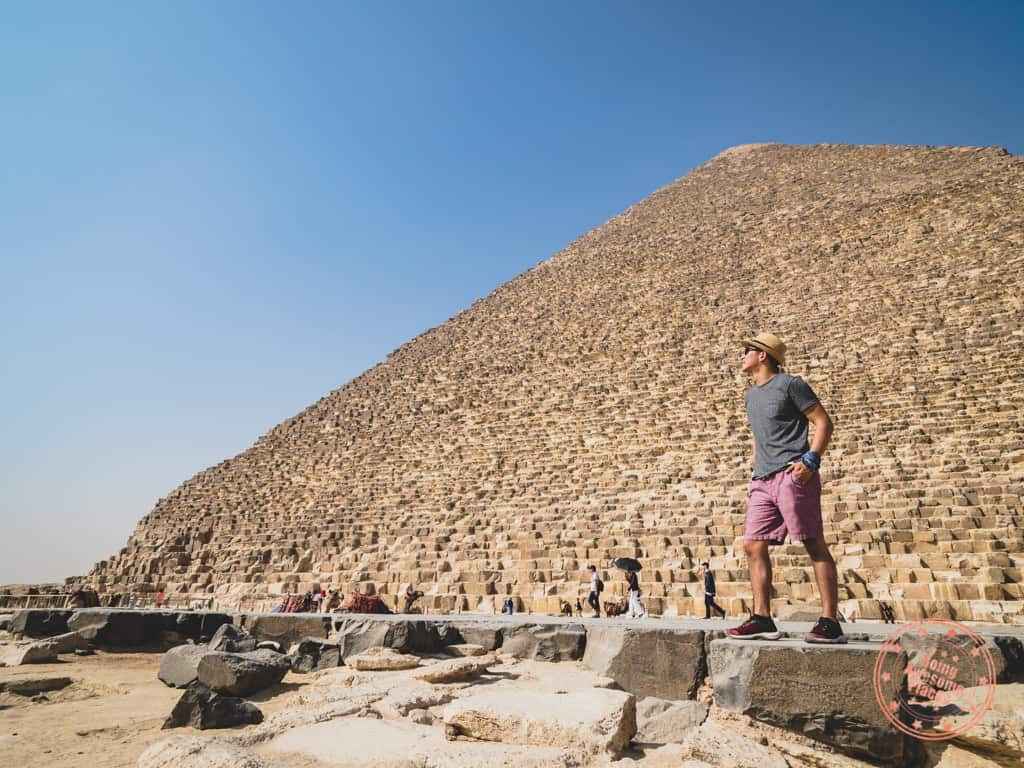 posing with buff headwear on wrist while standing in front of great pyramid