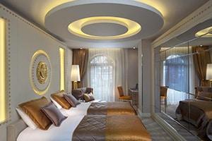 sura design hotel and suites opulent bedroom with two queen beds