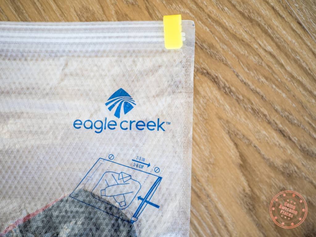 close up of eagle creek compression sac with focus on yellow ziplock slider