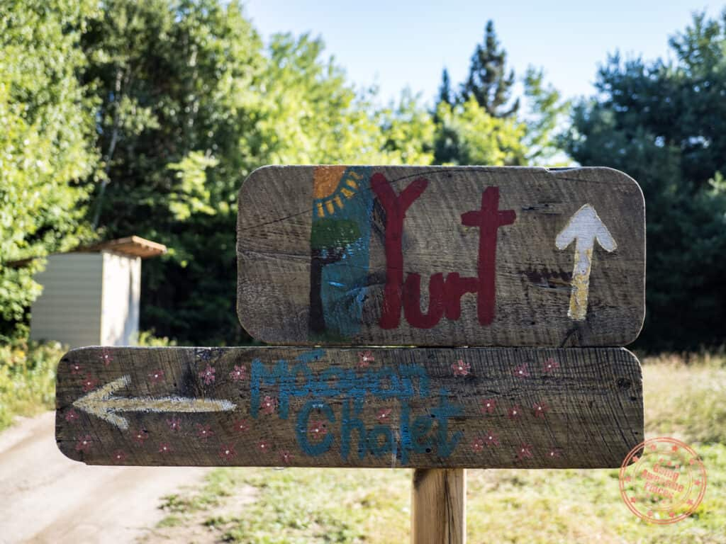 yurt sign pointing ahead and chalet to the left at nature's harmony ecolodge