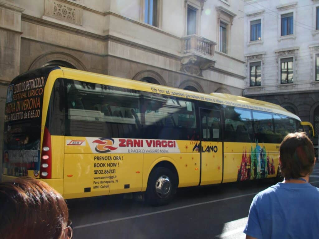 yellow city tour bus on the streets of sorrento