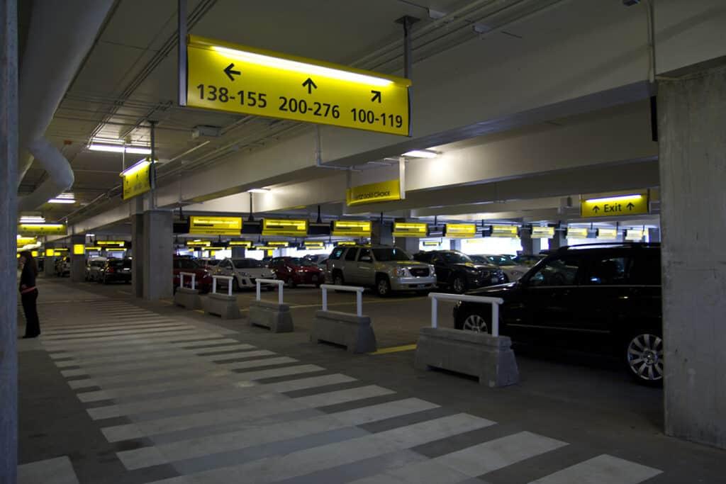 hertz car rental aisles at airport parking garage
