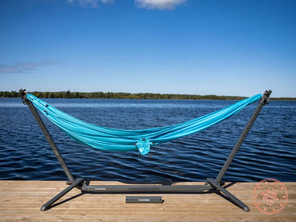 kammok swiftlet on a wooden deck with the roo single hammock attached in lounge mode