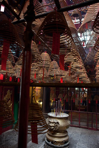 inside man mo temple in hong kong with cone incense