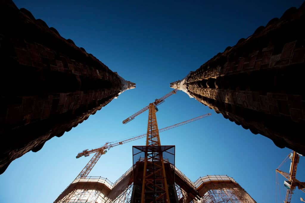 sagrada familia construction spires in barcelona with a ground looking up perspective