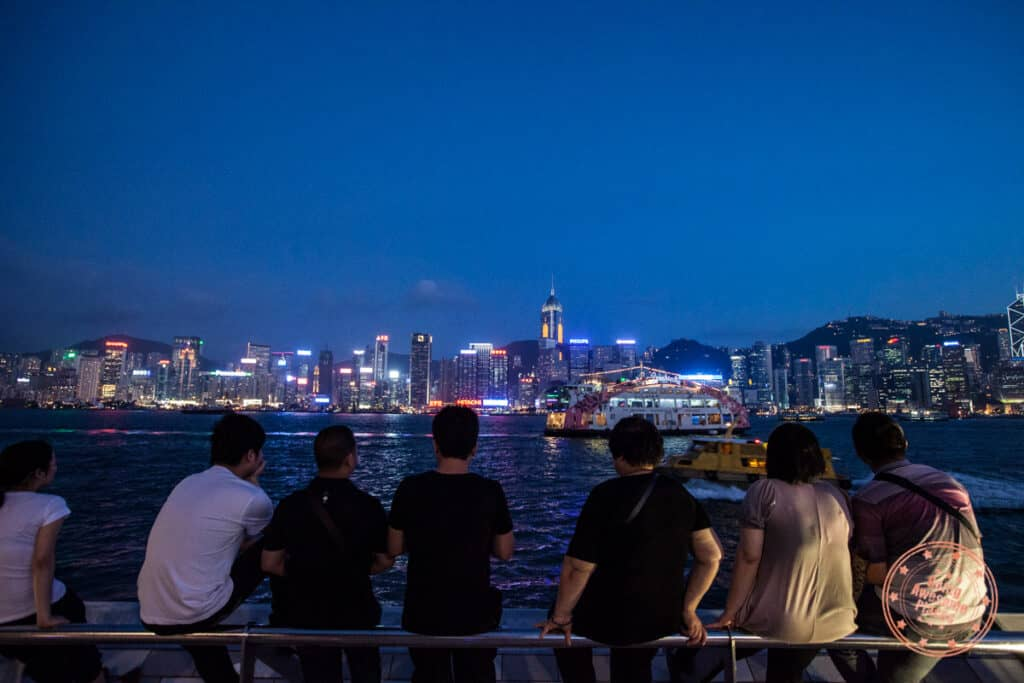 crowd of teenagers watching symphony of lights in hong kong