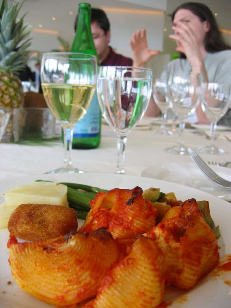 photo of pasta and vegetables with wine at dinner table in things to do in sorrento