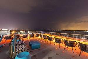 rooftop patio at night of the springhill suites by marriott.