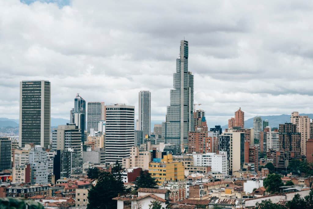 sky scrapers and apartments buildings in the distance in this where to stay in bogota guide