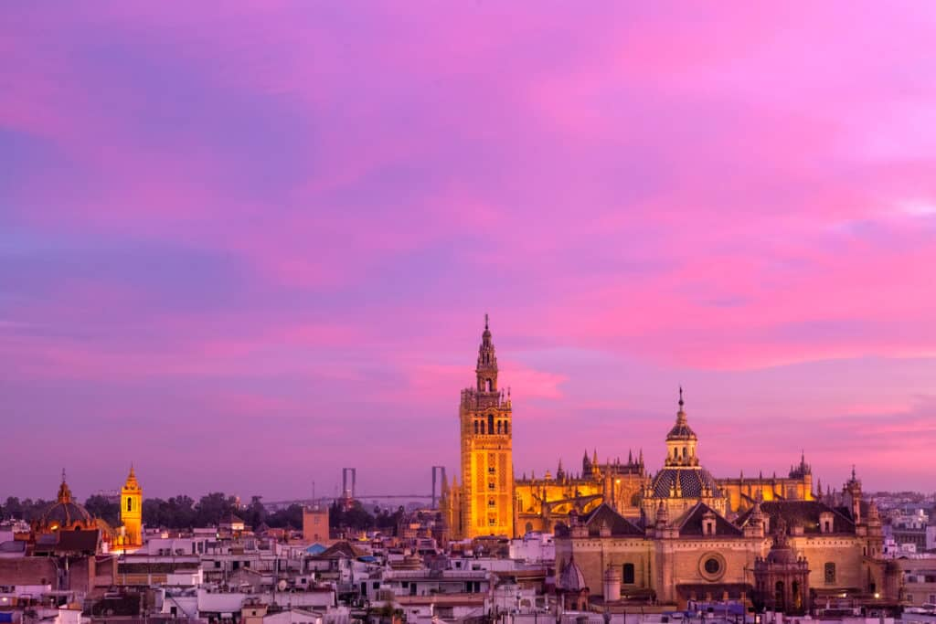 sunset across the city in the where to stay in seville neighborhood guide